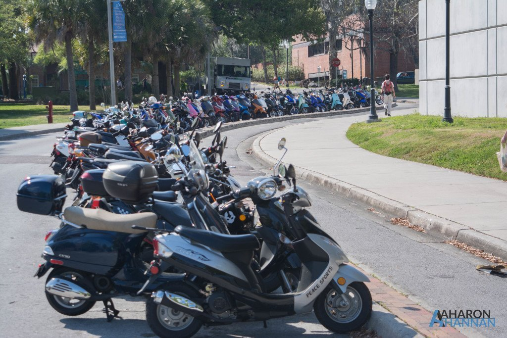 Students park their scooters in a line before they head to class